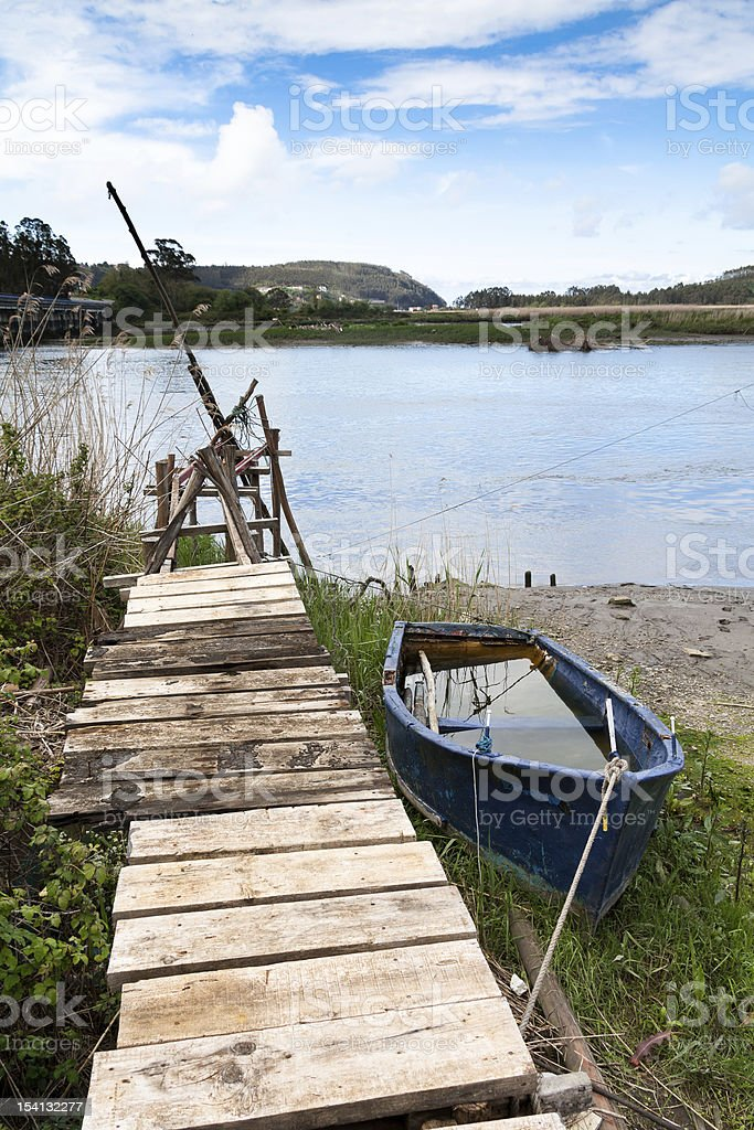Boat aground and the pier royalty-free stock photo