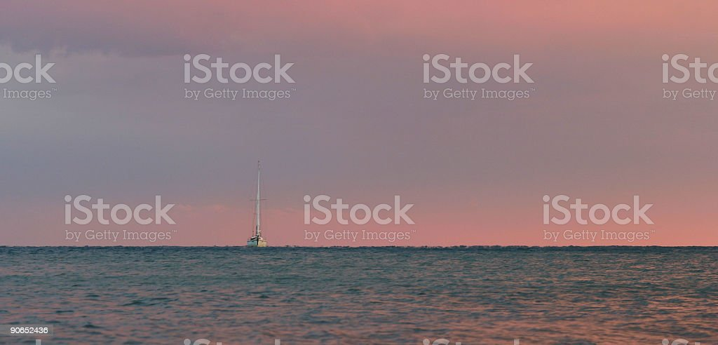 Boat alone on the see after sunset stock photo