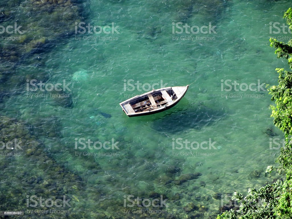 Boat anchored at Bay of All Saints in Brazil stock photo