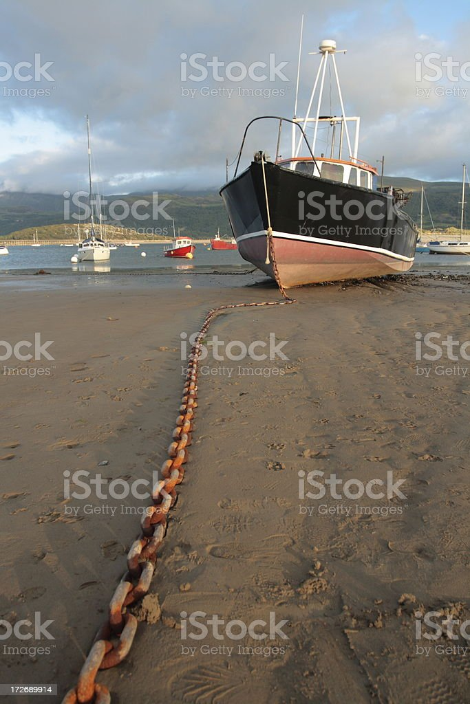 Boat Anchored at Low Tide stock photo