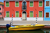 Boat anchored in canal in Burano, Venice, Italy