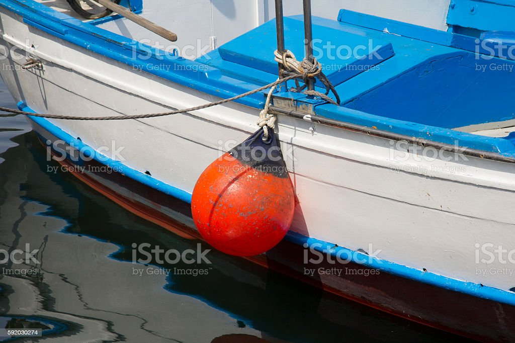 Boat anchored in the harbor stock photo