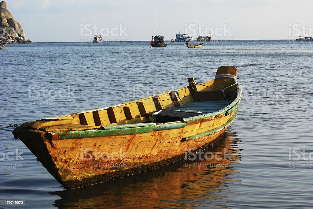boat anchored near the shore royalty-free stock photo
