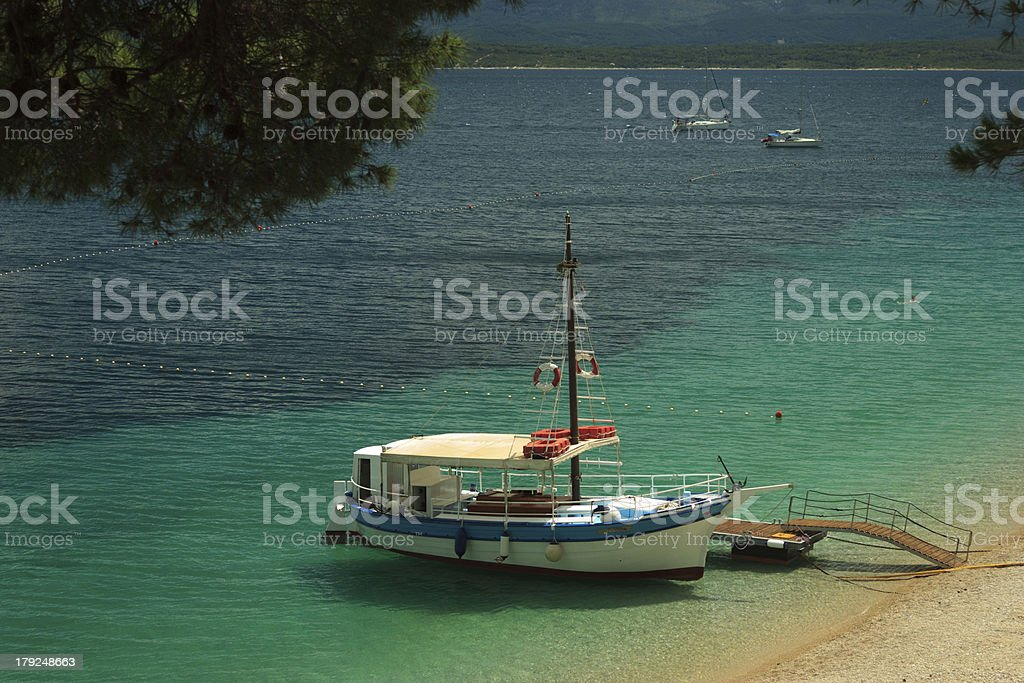 Boat anchorer on beach royalty-free stock photo