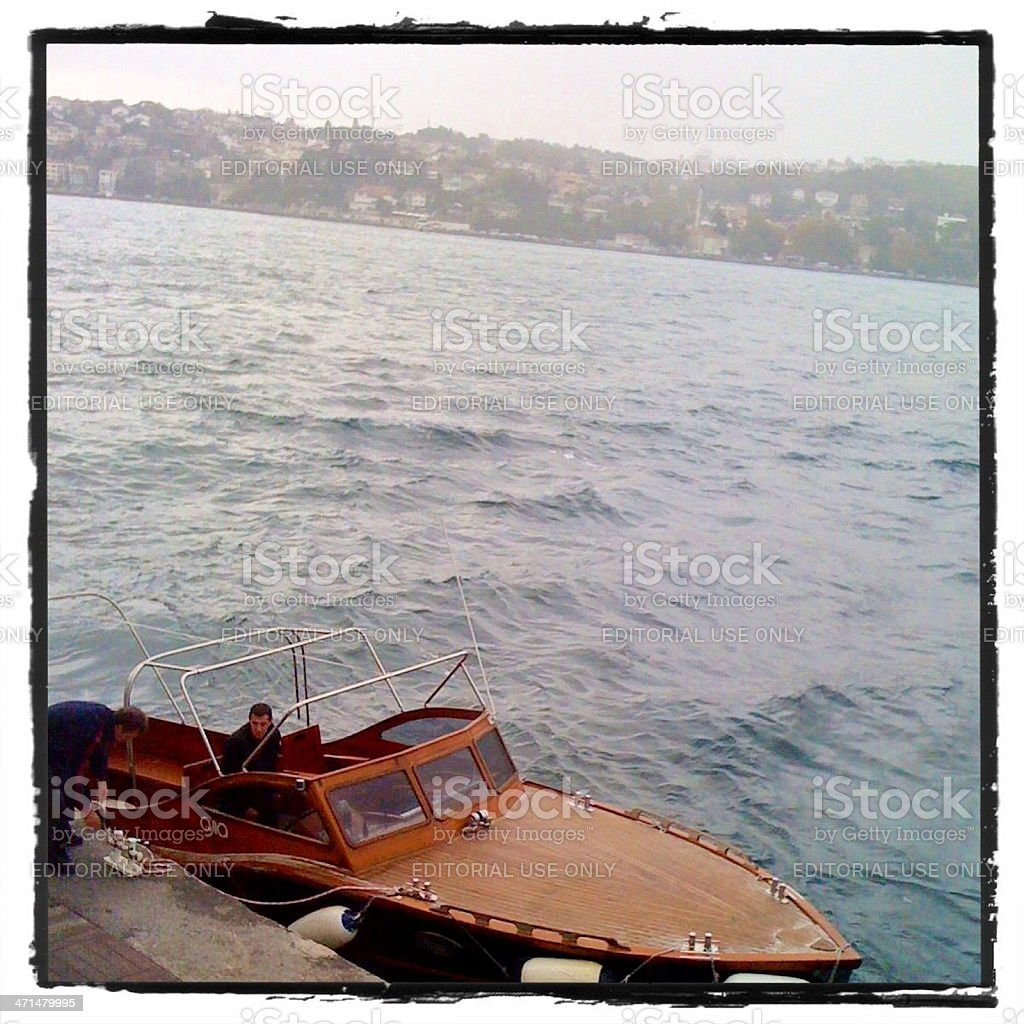 Boat anchoring at the coast of Bosphorus, Istanbul, Turkey stock photo