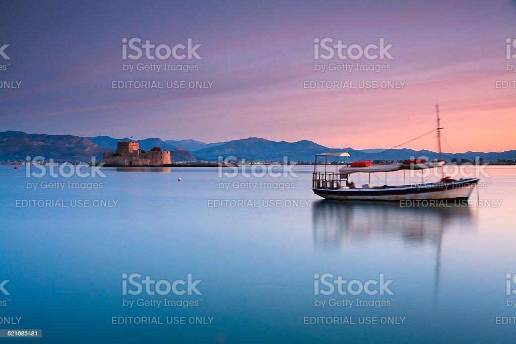 Boat and a castle, Nafplio, Greece. stock photo