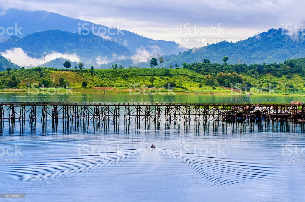boat and a wooden bridge in the fresh morning stock photo