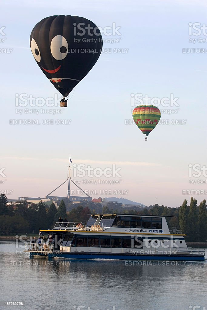 Boat and air balloons lake Burley Griffin stock photo