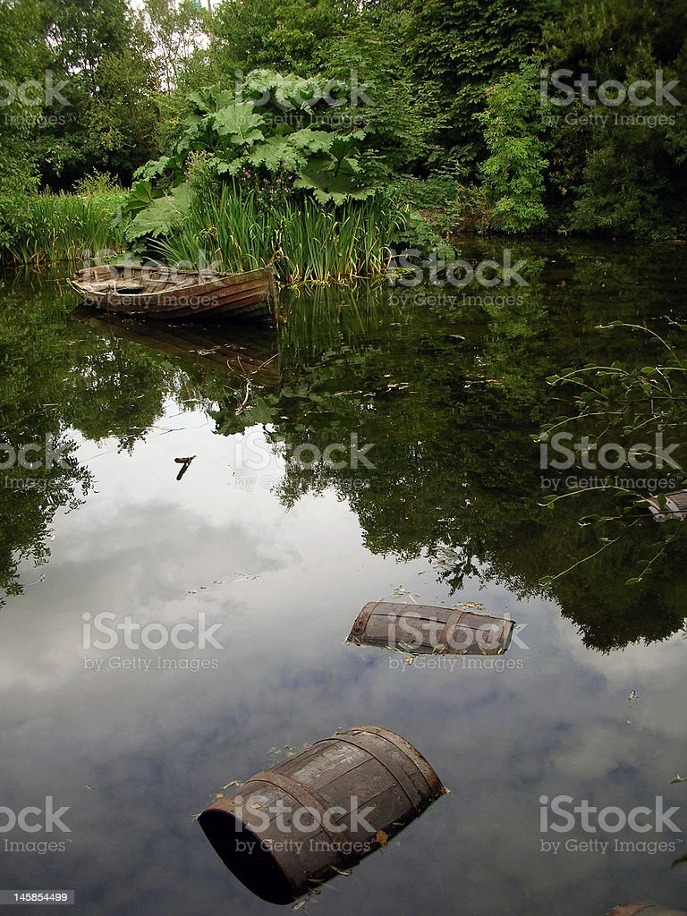Boat and Barrels in a lake stock photo