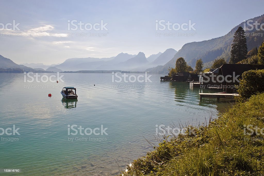 boat and boathouses on a mountain lake stock photo