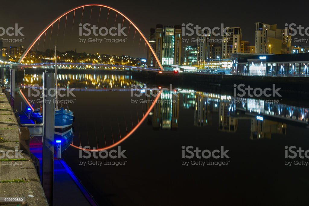 Boat and Bridges night-time photograph of Newcastle and Gateshea stock photo