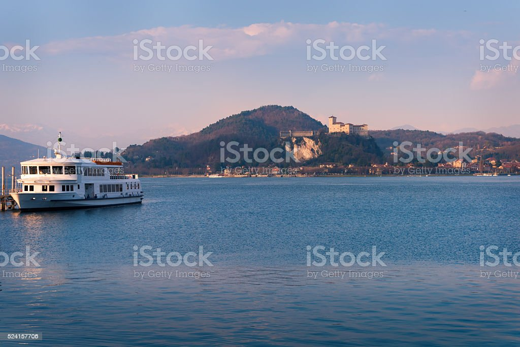Boat and fortress of Angera stock photo