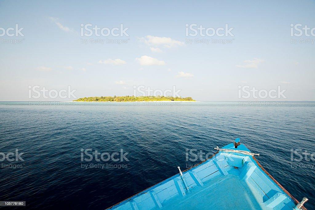 Boat and Havodigalaa Island, South Huvadhu Atoll, Maldives stock photo