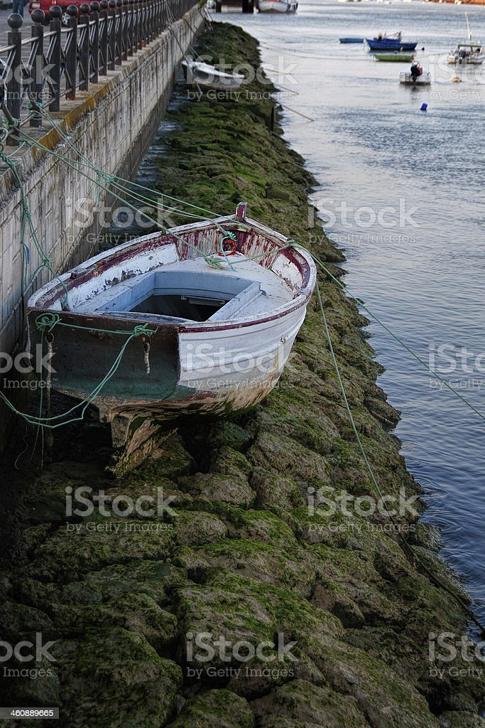 Boat and low tide stock photo