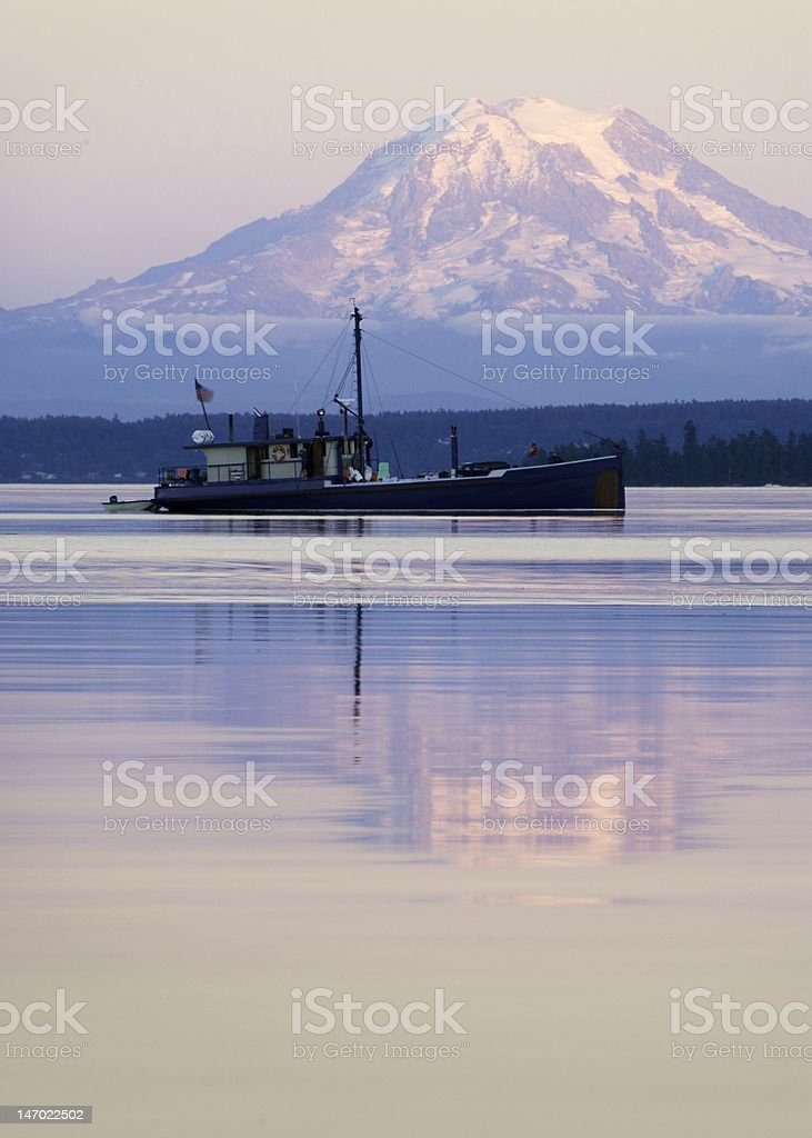 Boat and Mt. Rainier in Late Afternoon stock photo