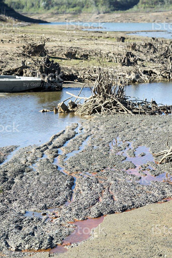 Boat and Poluted Dying Vogrscek Lake Slovenia royalty-free stock photo
