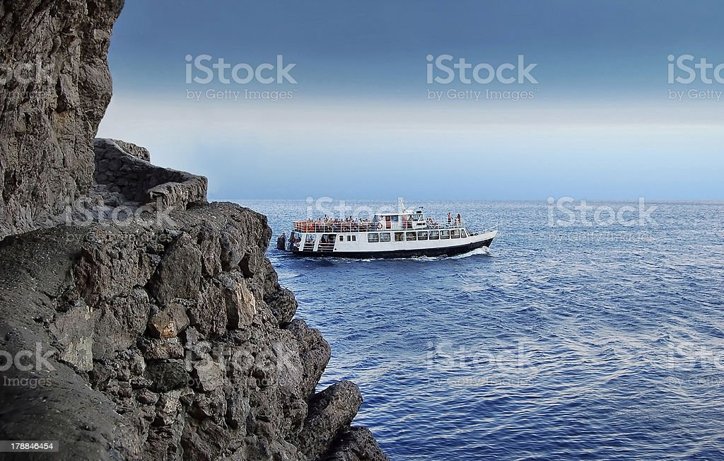 Boat and rock royalty-free stock photo