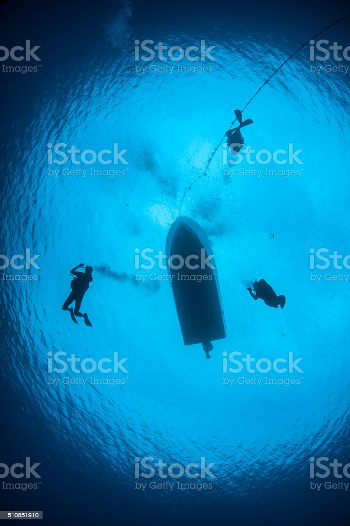 Boat and Scuba Divers in Blue Water stock photo