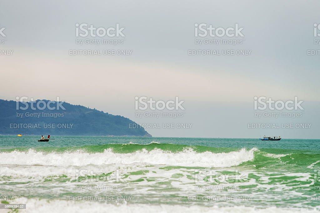 Boat and ship at China Beach in Danang in Vietnam stock photo