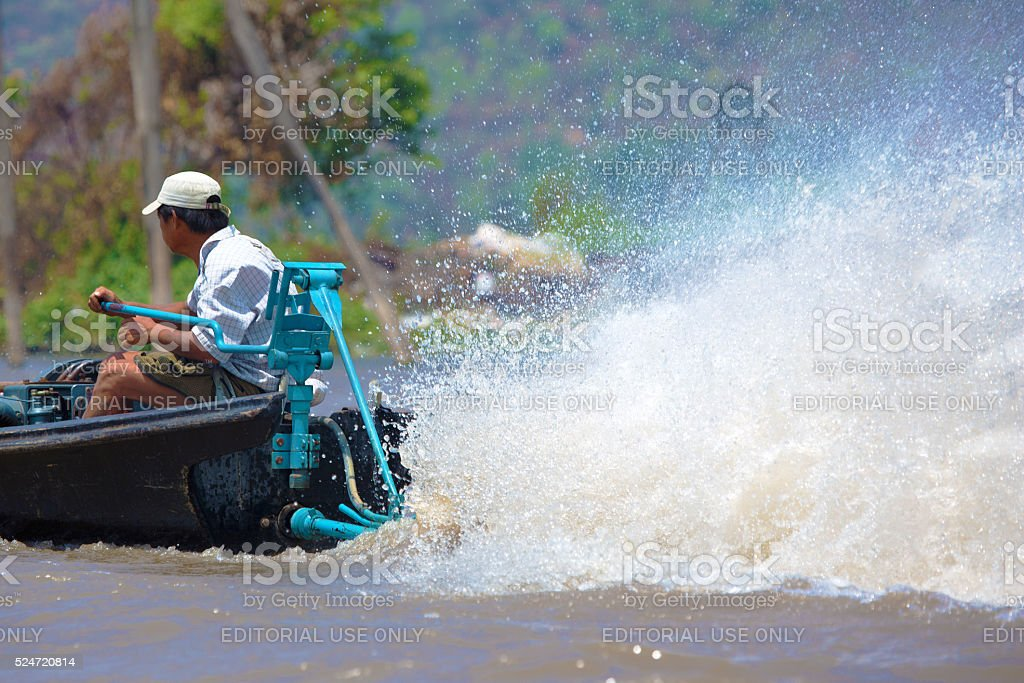 Boat and spray on lake Inle, Myanmar stock photo