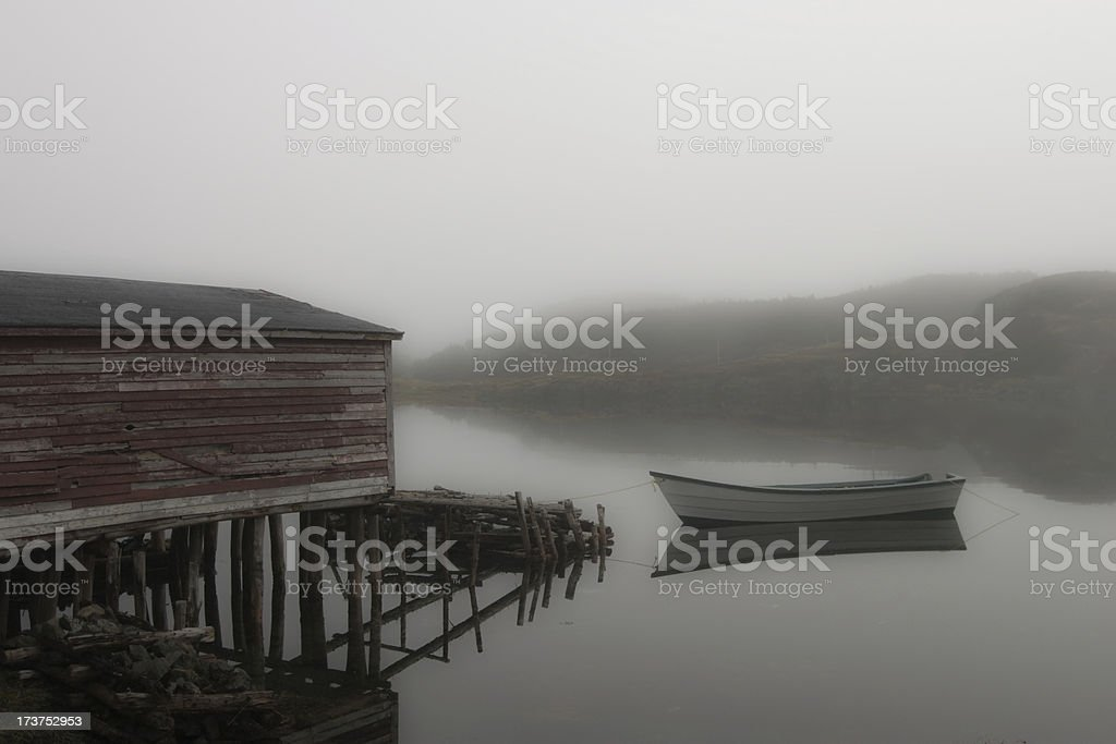 boat and stage on a foggy day royalty-free stock photo