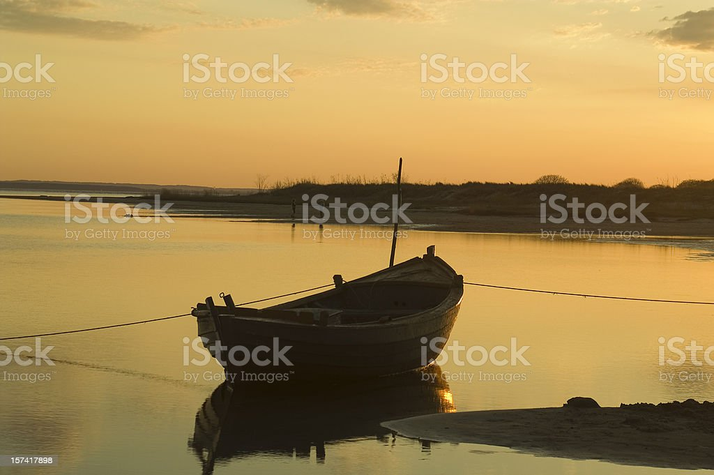Boat and sunset royalty-free stock photo