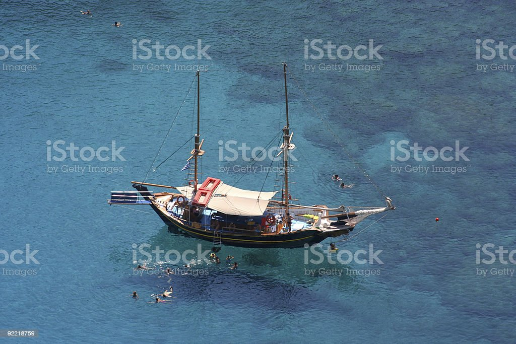 Boat And Swimmers From High Angle royalty-free stock photo