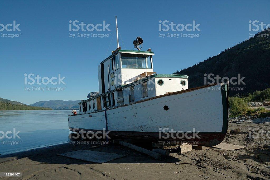 Boat and the Yukon River at Dawson City. royalty-free stock photo