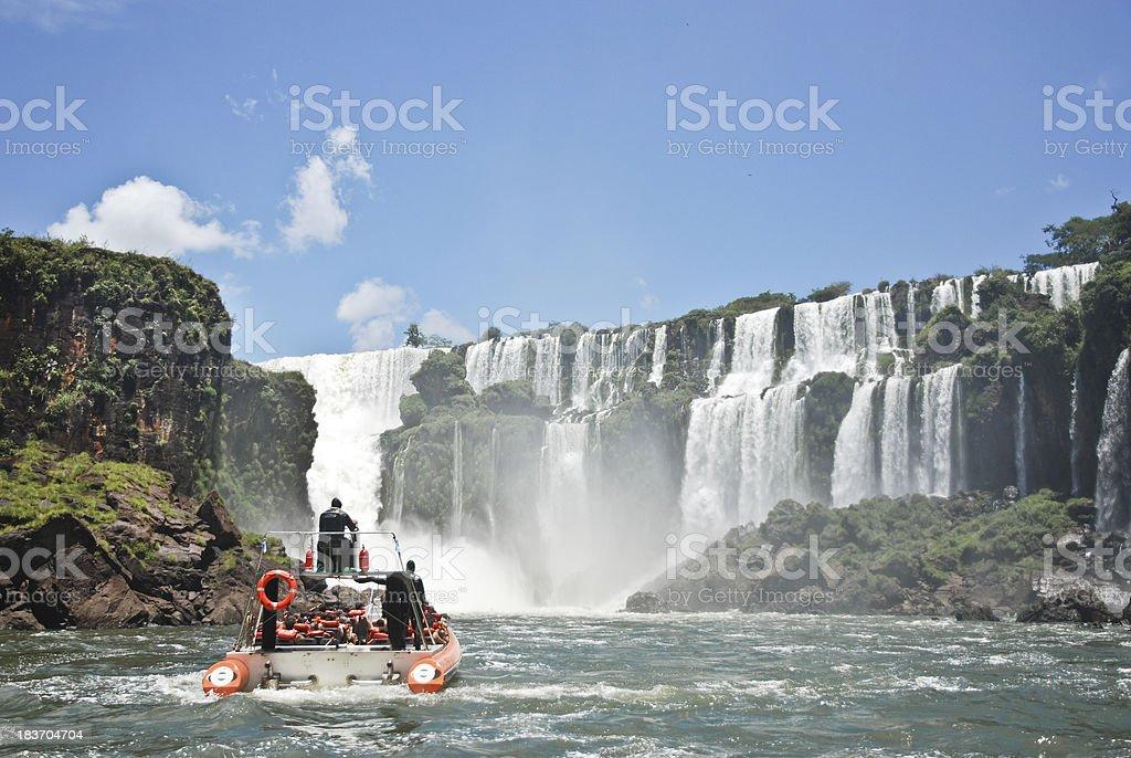 Boat approaching Iguazu Falls stock photo