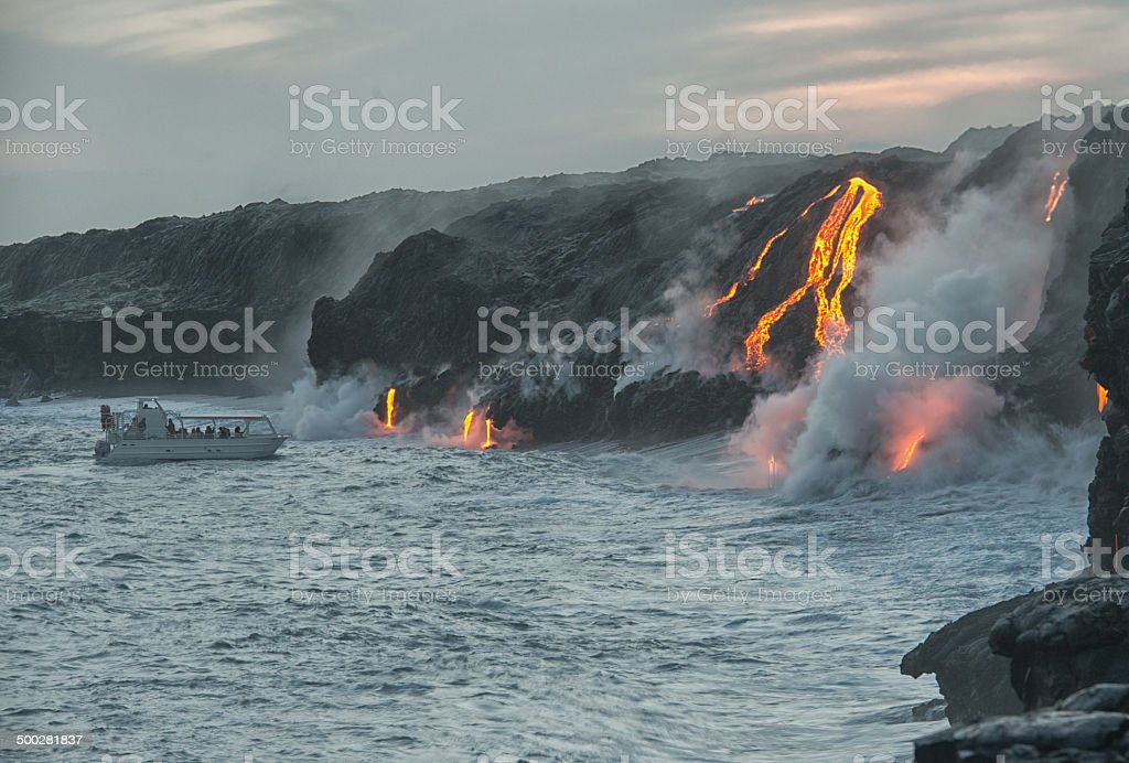 Boat approaching lava stock photo