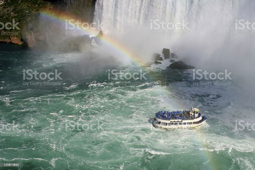 Boat approaching the waterfall royalty-free stock photo