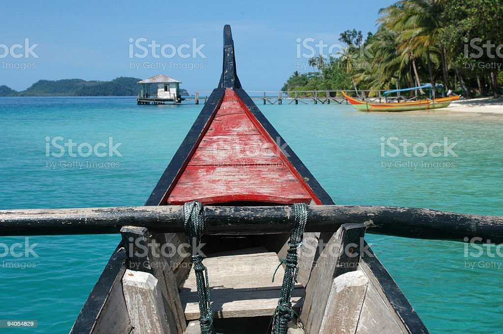 Boat arriving on island stock photo