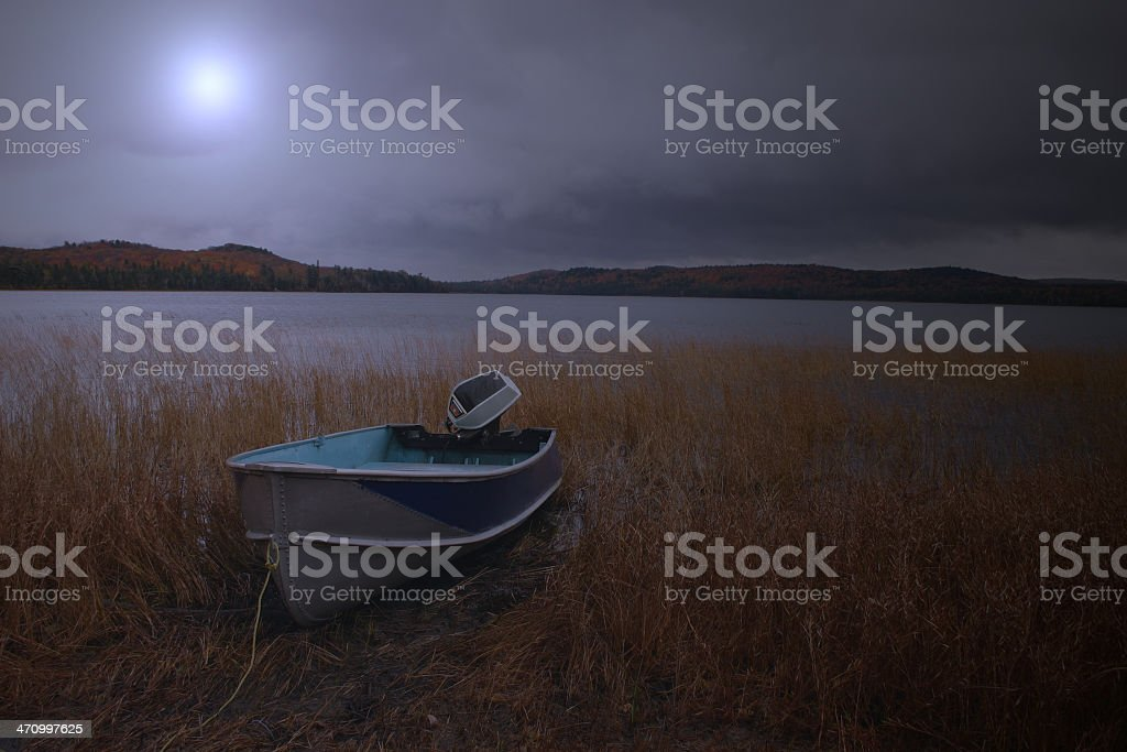 Boat at a Lake on Moonlit Night royalty-free stock photo