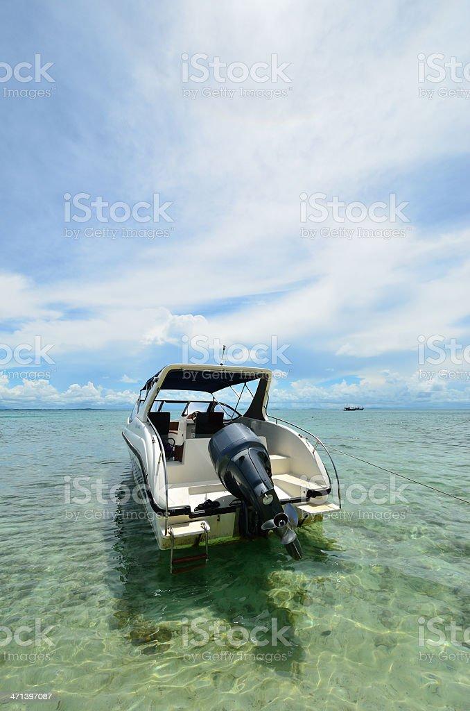 Boat at Beach talu Island stock photo
