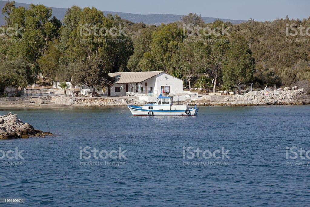 boat at coast of gulluk bay in bodrum mugla turkey royalty-free stock photo
