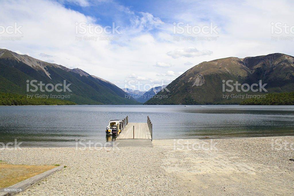 Boat at Jetty in Beautiful Lake Rotoiti, Nelson, New Zealand stock photo