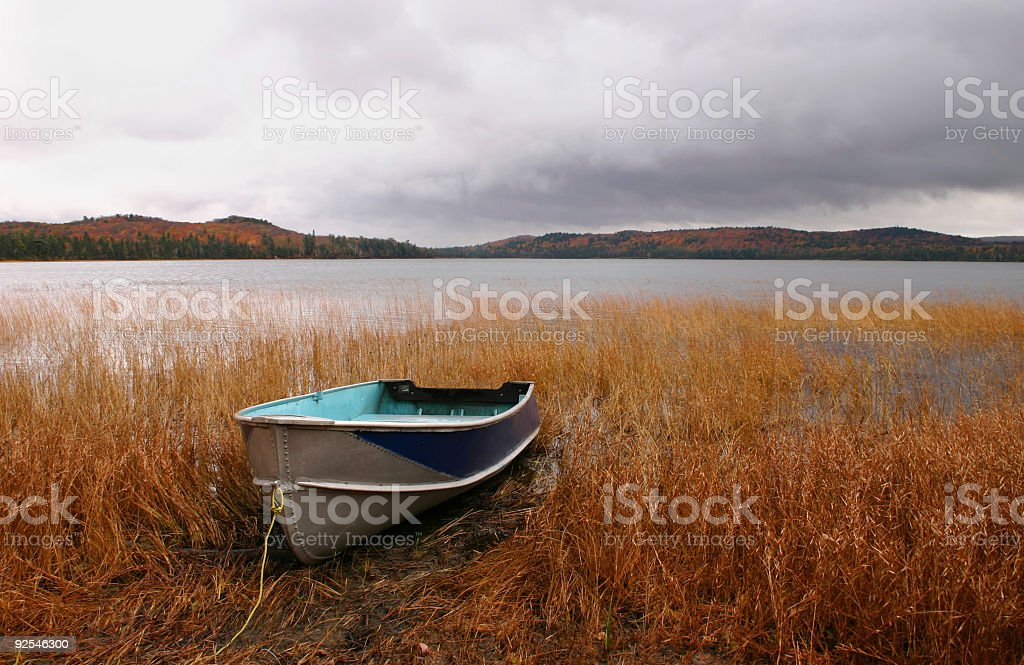Boat at Lake in Autumn stock photo