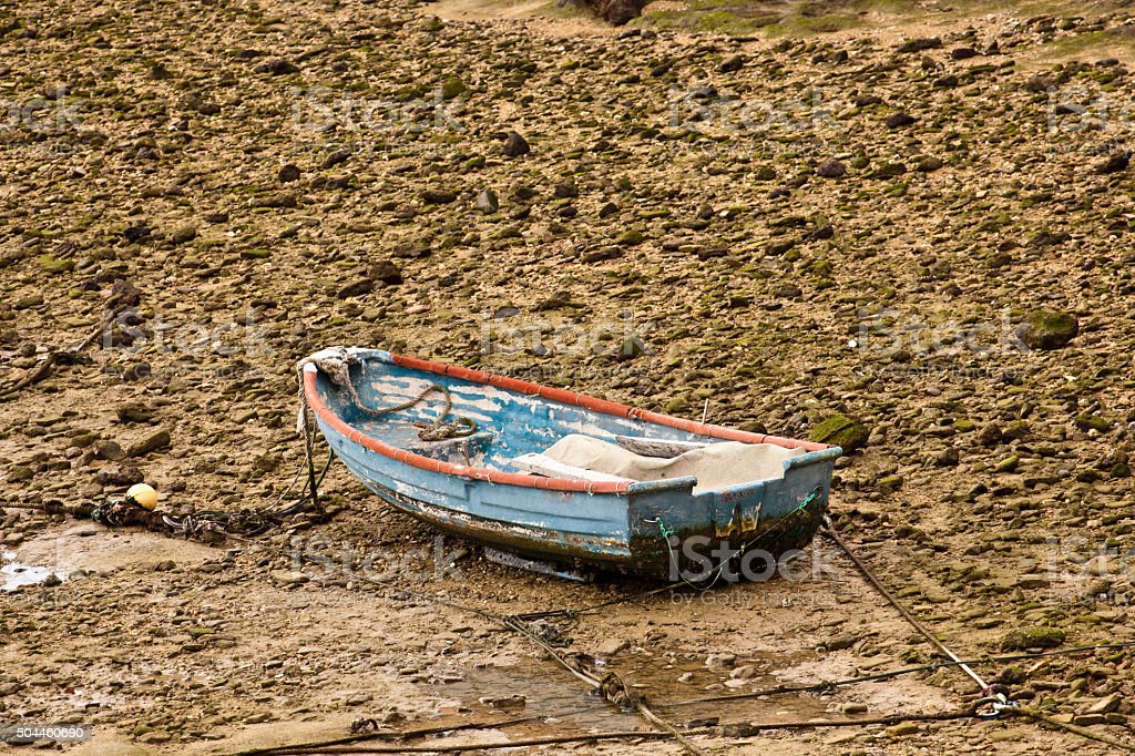 boat at low tide stock photo