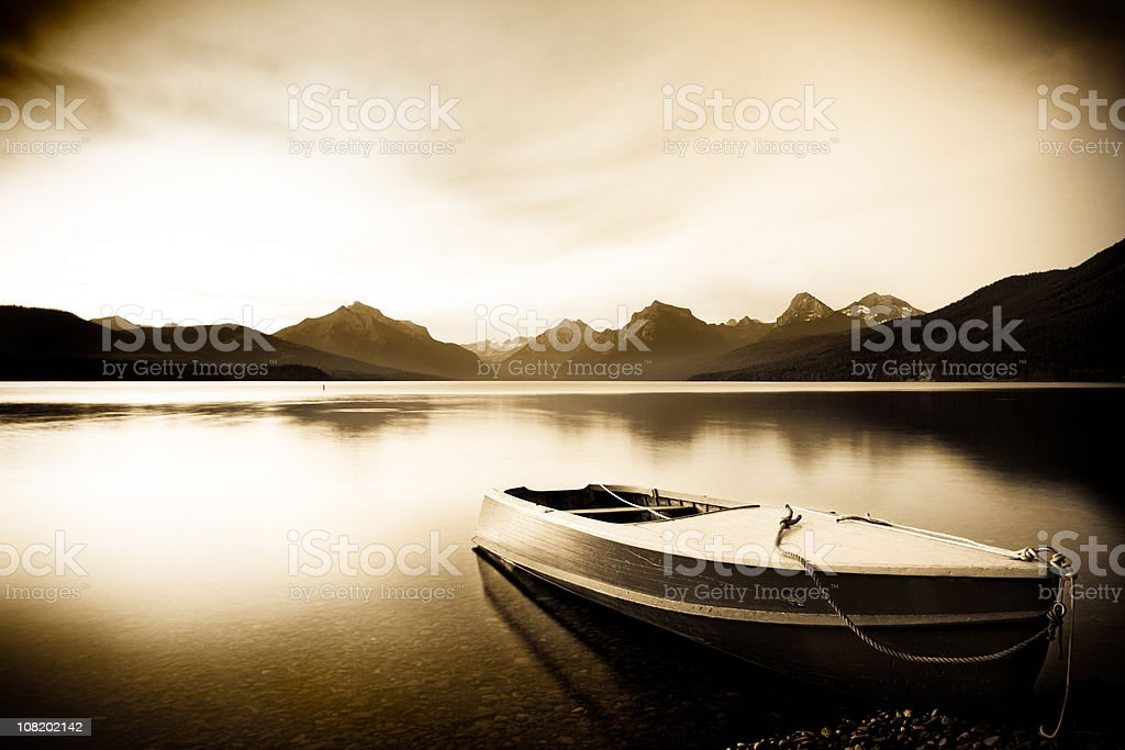 Boat at rest on a placid lake in Montana royalty-free stock photo