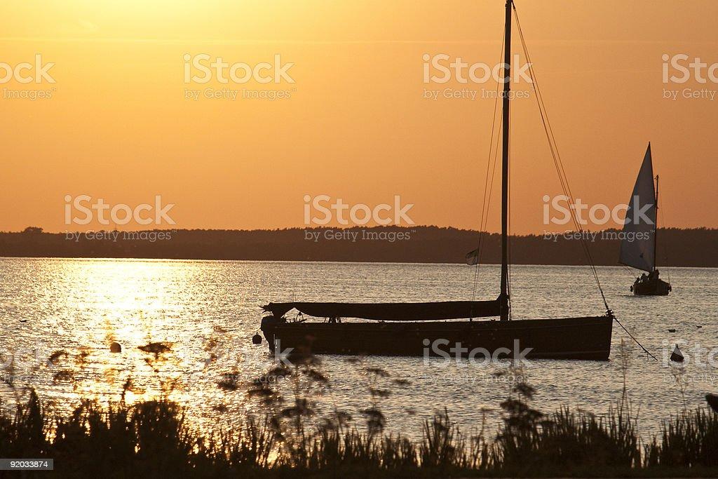 boat at sundown royalty-free stock photo