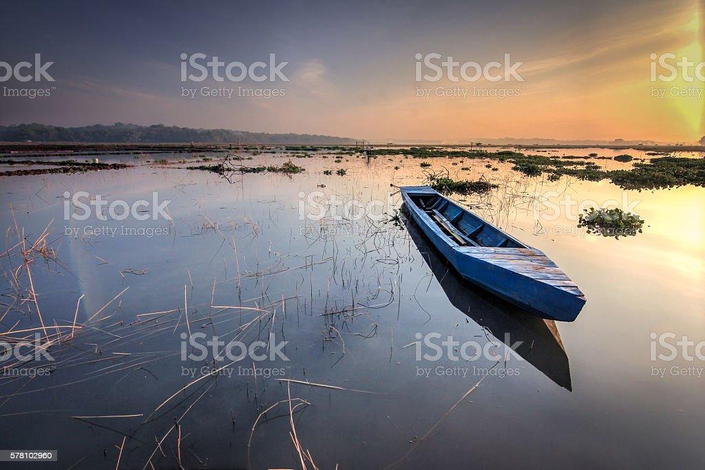 Boat at sunrise stock photo