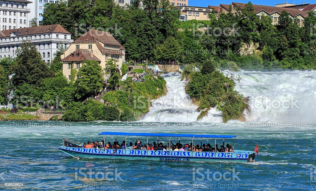 Boat at the Rhine Falls in Switzerland stock photo