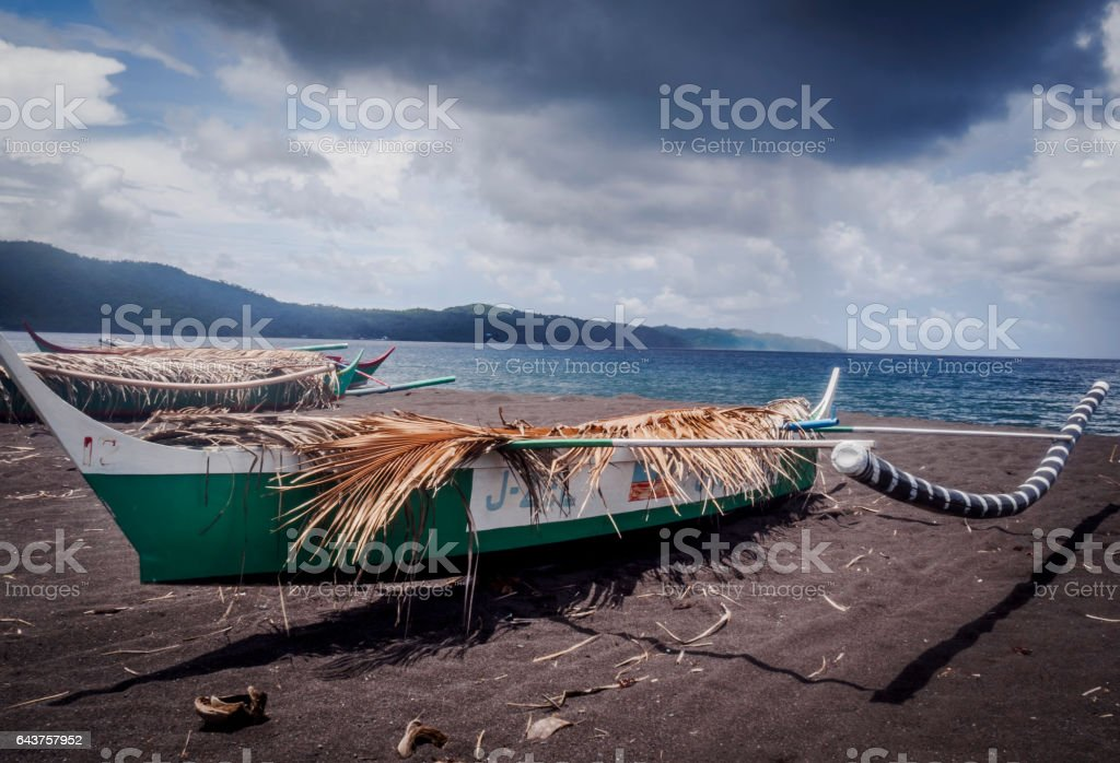 Boat at waterfront with storm coming stock photo