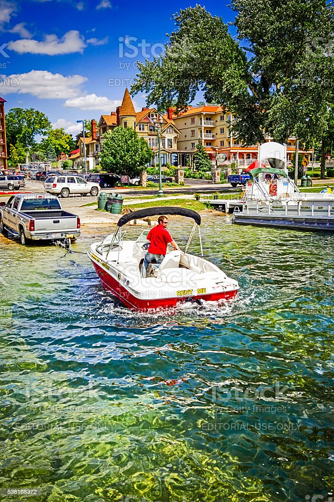 Boat being launched from a trailer into Lake Geneva Wisconsin stock photo