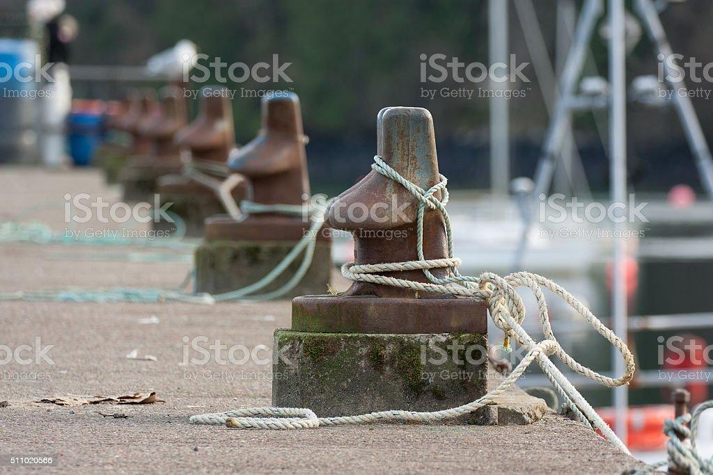boat bollards and ropes stock photo