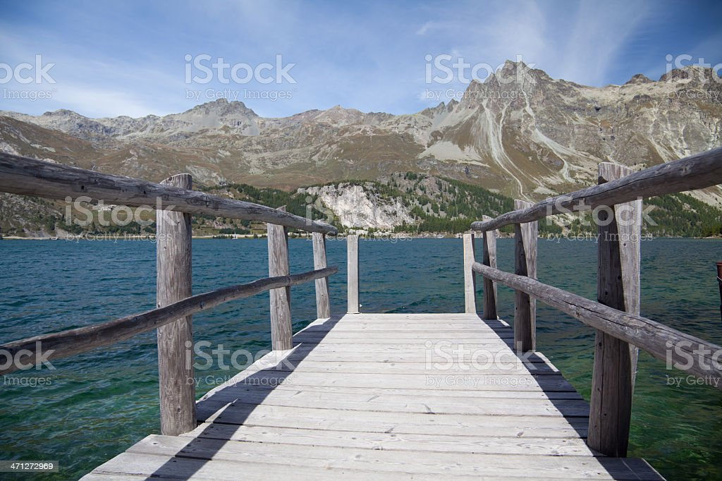 Boat Bridge at Lake Sils with Piz Lagrev, Engadine, Switzerland royalty-free stock photo