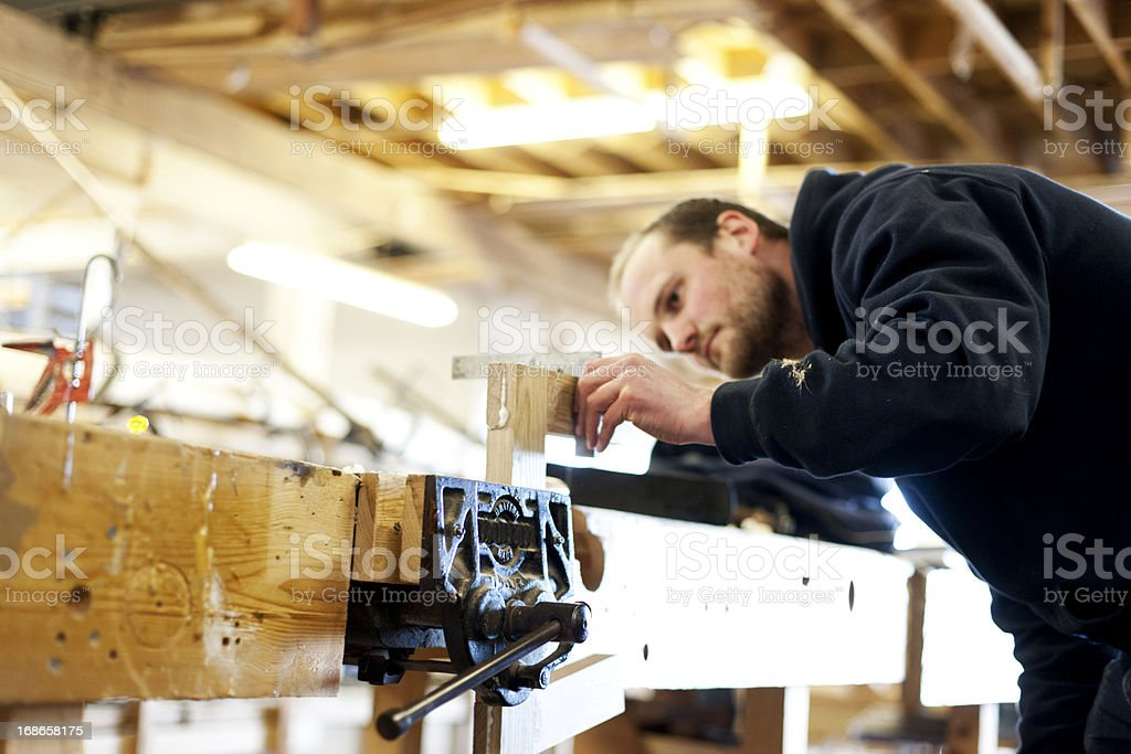 Boat builder using an angle stock photo