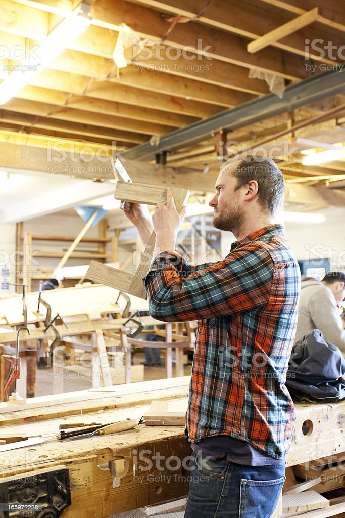 Boat builder working on a joint royalty-free stock photo