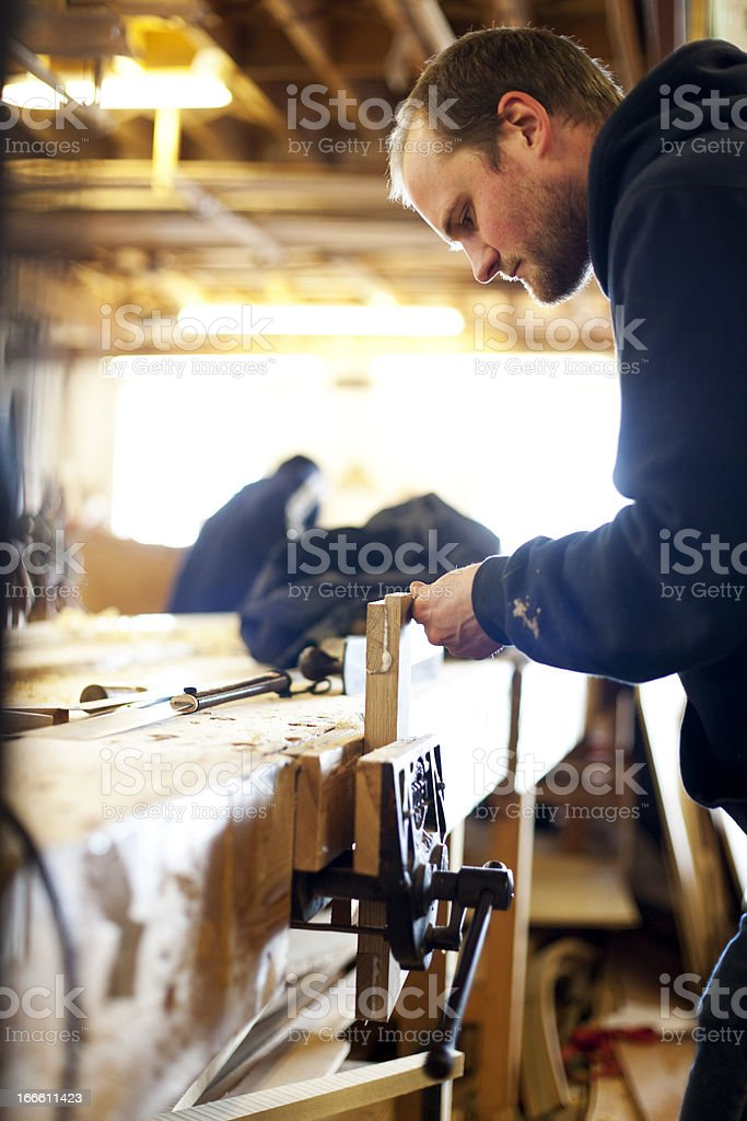 Boat builder working on a joint stock photo