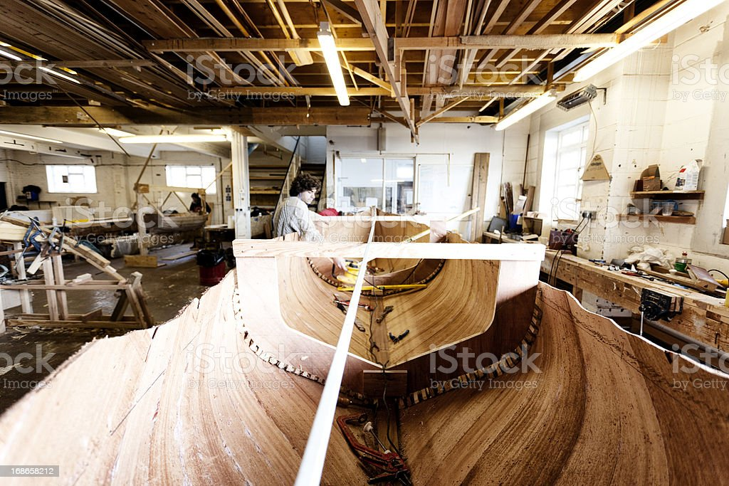 Boat builder working on the craft interior stock photo